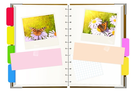 Notebook with photos. Object isolated over white photo