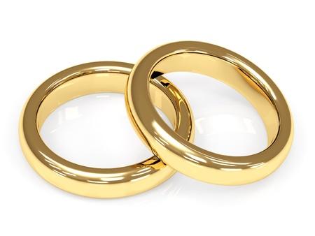 aniversario de boda: Dos 3d oro anillos de boda. Objetos en blanco Foto de archivo