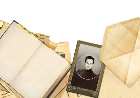 Frame with old book and photo. Objects isolated over white photo