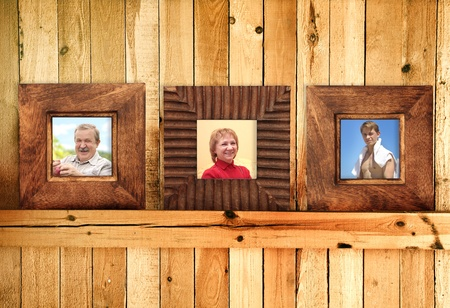 Three frames with family photos on wooden wall photo