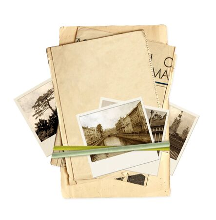 Frame with old paper and photos. Objects isolated over white Stock Photo - 9521757