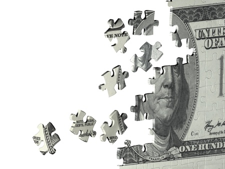 Puzzle with the image of dollar. Isolated over white photo