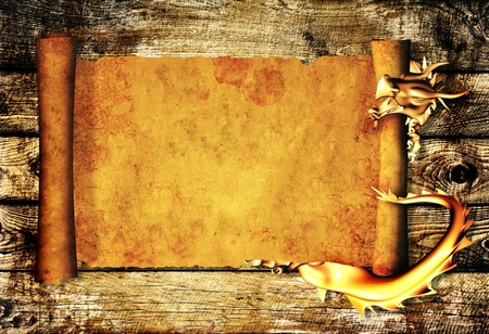 Dragon and scroll of old parchment. Over wooden planks photo