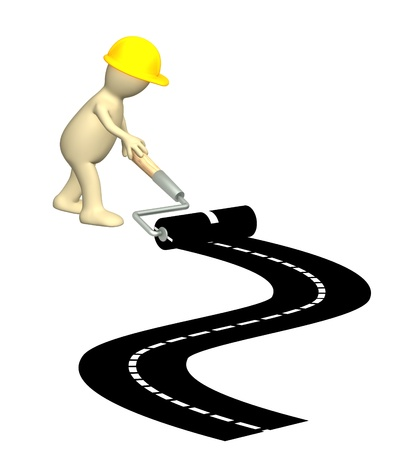 Puppet, making a new road. Isolated over white Stock Photo - 9744405