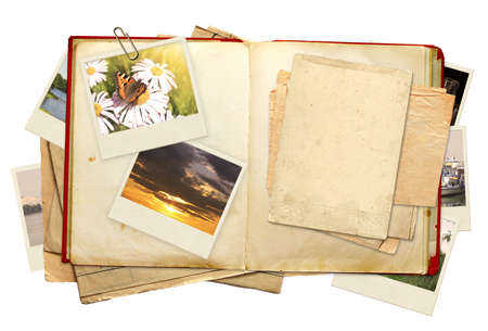 old diary: Old book and photos. Objects isolated over white