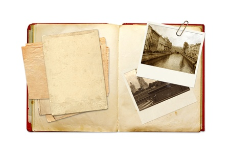 diary page: Old book and photos. Objects isolated over white