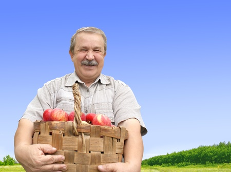 Senior man, harvesting a apple photo