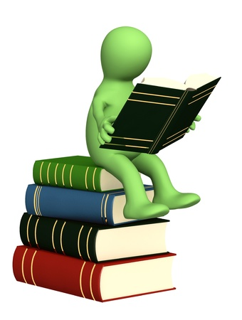 3d puppet, reading the book. Isolated over white photo