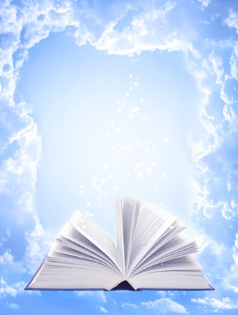 Magic book, blue sky and white clouds photo
