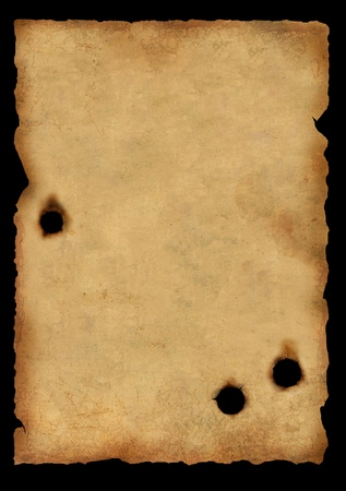 old poster: Sheet of an old paper injured by bullets. Isolated over black