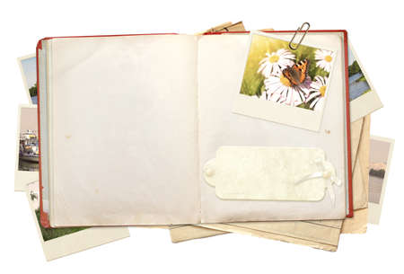 open diary: Old book and photos. Objects isolated over white