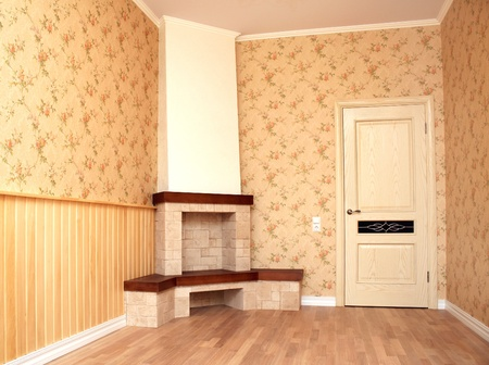 Interior of a room with a fireplace. Retro style photo
