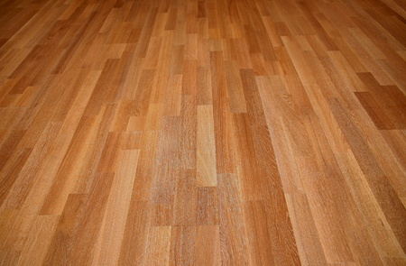 laminate flooring: New oak parquet of brown color