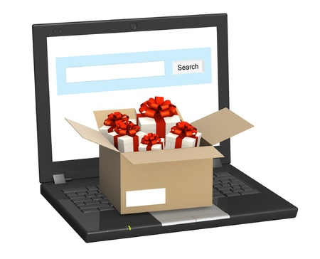 Laptop and many gifts. Objects isolated over white photo