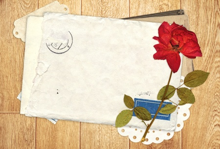 Old envelope and dry pose for scrapbooking design photo