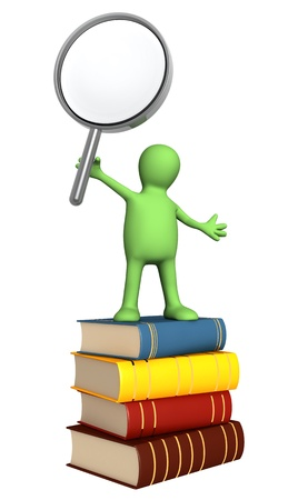 Puppet with loupe and books. Isolated over white photo