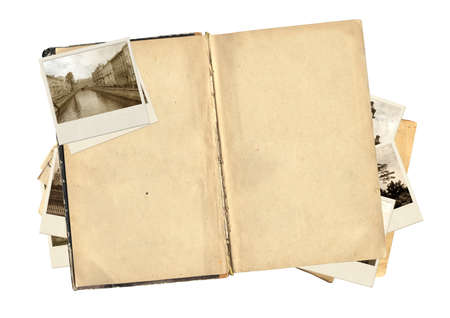 Old book and photos for scrapbooking design. Isolated over white photo