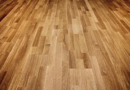 hardwood floor: New oak parquet of brown color