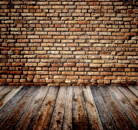 indoor background: Old room with brick wall and wooden floor