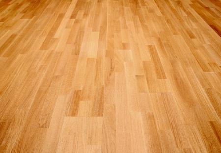 on wood floor: New oak parquet of brown color