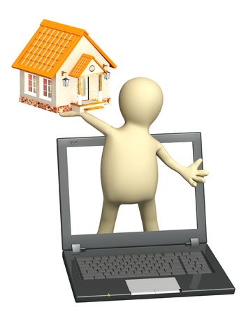 Puppet with laptop and house. Isolated over white photo