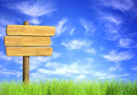 Letrero de madera. Objetos en el cielo azul Foto de archivo
