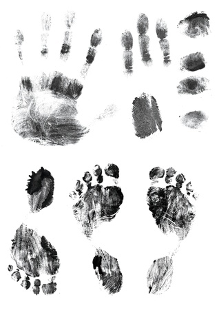 Black silhouettes of prints of fingers and foot  Isolated over white photo