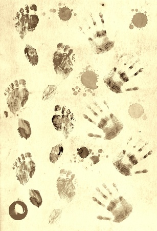 Prints of palms and foots over paper texture photo