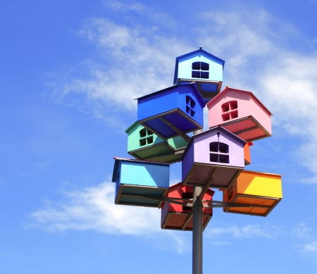 Colorful nesting boxes on blue sky photo