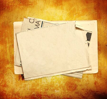 Sheet of old paper on stucco wall Stock Photo - 16550234