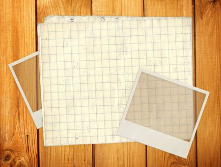 Old photos and paper for scrapbooking. Object over wooden plank