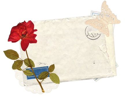Old envelope and dry pose for scrapbooking design. Isolated ower white Stock Photo - 16720422