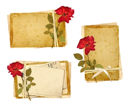 Set of old cards and dried rose for scrapbooking design. Object isolated over white photo