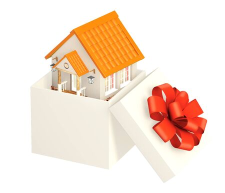 Maison dans un emballage cadeau. Isol� sur fond blanc photo