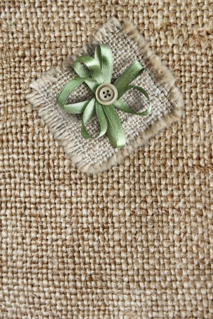 Background with fabric texture and button photo