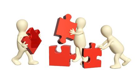 recoger: Imagen conceptual - el éxito del trabajo en equipo. Tres marionetas con rompecabezas. Aislado en el fondo blanco