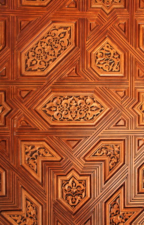Detail of antique carved wooden ornament in Alhambra, Spain photo