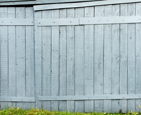 palisade: Old wooden fence and green grass Stock Photo