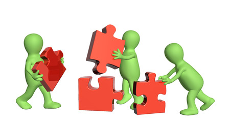 perplexing: Conceptual image - success of teamwork. Three puppets with puzzles. Isolated on white background Stock Photo