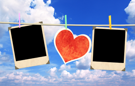 Old photos and paper heart on blue sky photo