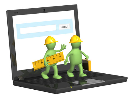 Two builders and laptop  Isolated on white background photo