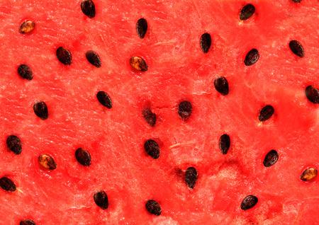 Red texture of sweet watermelon Фото со стока