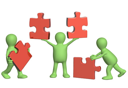 business relationship: Success of teamwork. Three puppets with puzzles. Isolated on white