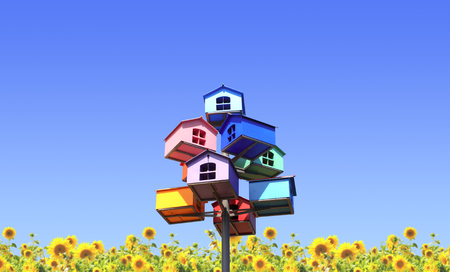 Colorful nesting boxes and sunflowers on blue sky photo