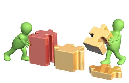 perplexing: Imagen conceptual - �xito del trabajo en equipo. Dos marionetas con rompecabezas. Aislado en el fondo blanco