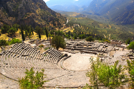 Ancient amphitheater and ruins of Temple of Apollo in the archaeological site of Delphi, Greece photo