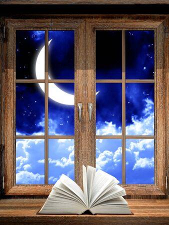 windowsill: Open book on wooden windowsill