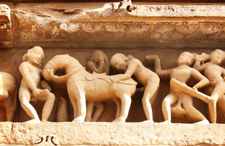 naked statue: Famous erotic human sculptures at temple in Khajuraho, India Stock Photo