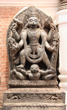 incarnation: Ancient stone statue of Narasimha, Lion-headed God, an avatar of Vishnu, in Bhaktapur, Kathmandu valley, Nepal. UNESCO World Heritage