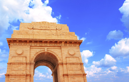 india gate: India Gate memorial in New Delhi, India. On blue sky background